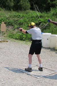 Senior shooting a pistol