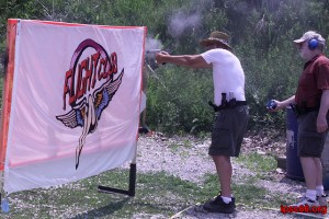 senior shoots around a wall at USPSA match