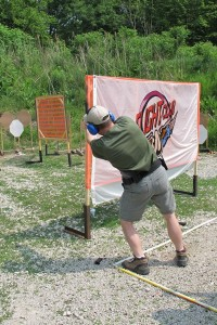 Shooting around a wall at USPSA stage