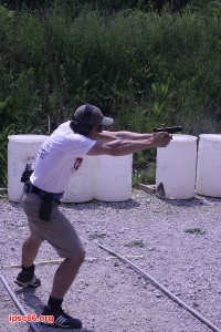 USPSA shooter leaning for a wide shot